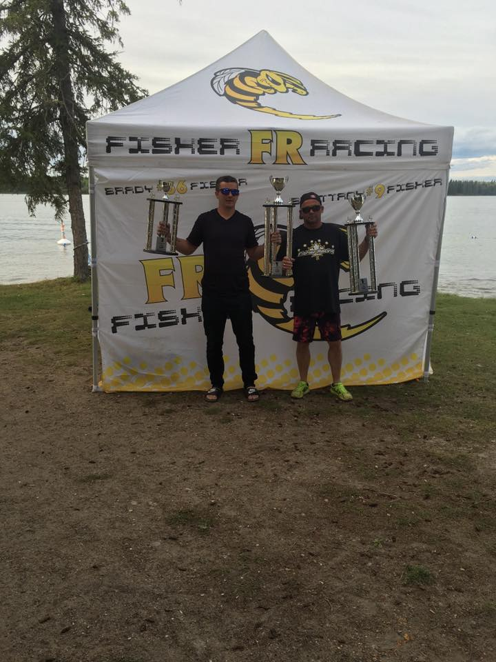 Brady Fisher and his dad. The tour sponsors Fisher powerlines